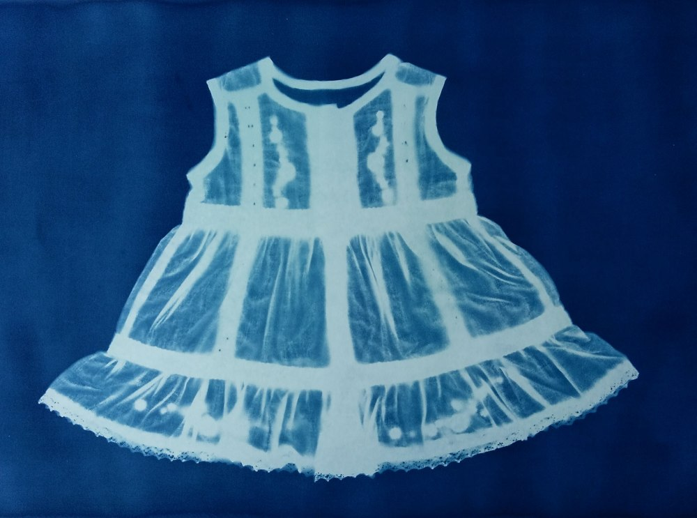 Cyanotype of baby dress