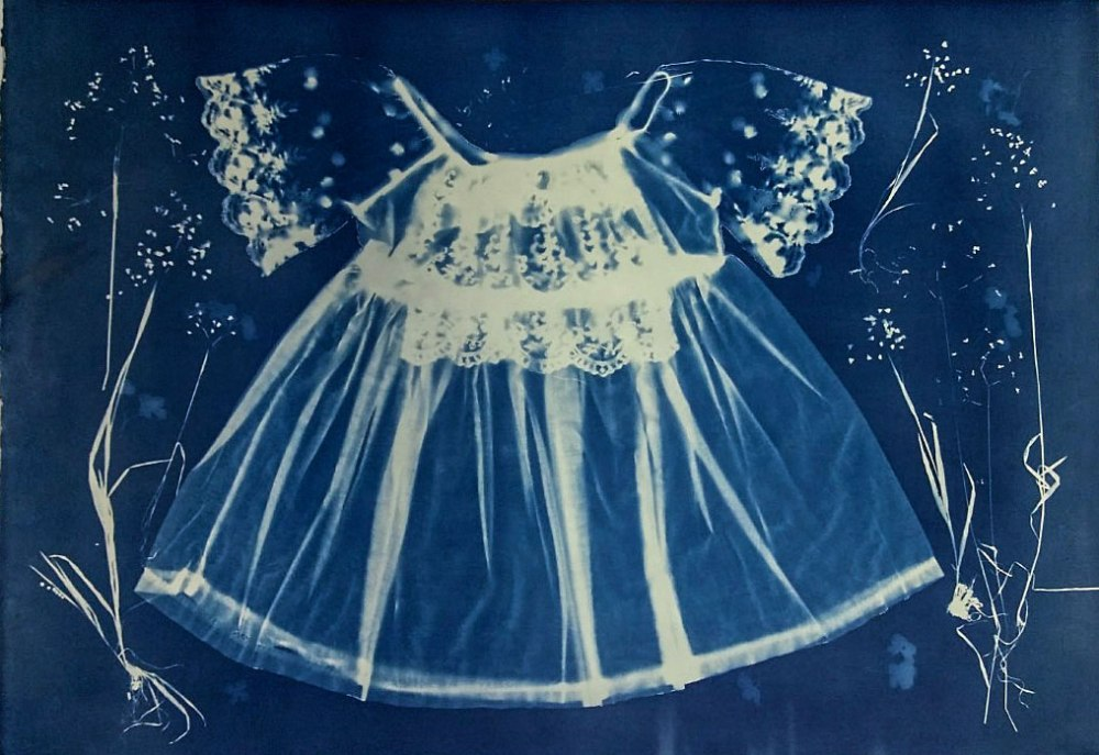 Cyanotype of baby dress and grasses