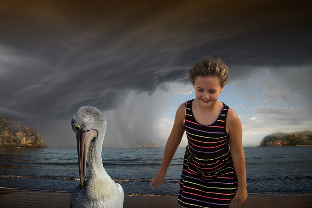 A photo of my granddaughter with a pelican