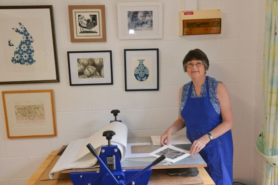 Jennifer in her studio at Mapleton with her ABIG printing press.